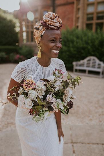 Bride wearing Wtoo Lenora wedding dress and Hermione Harbutt tassel earrings in Surrey