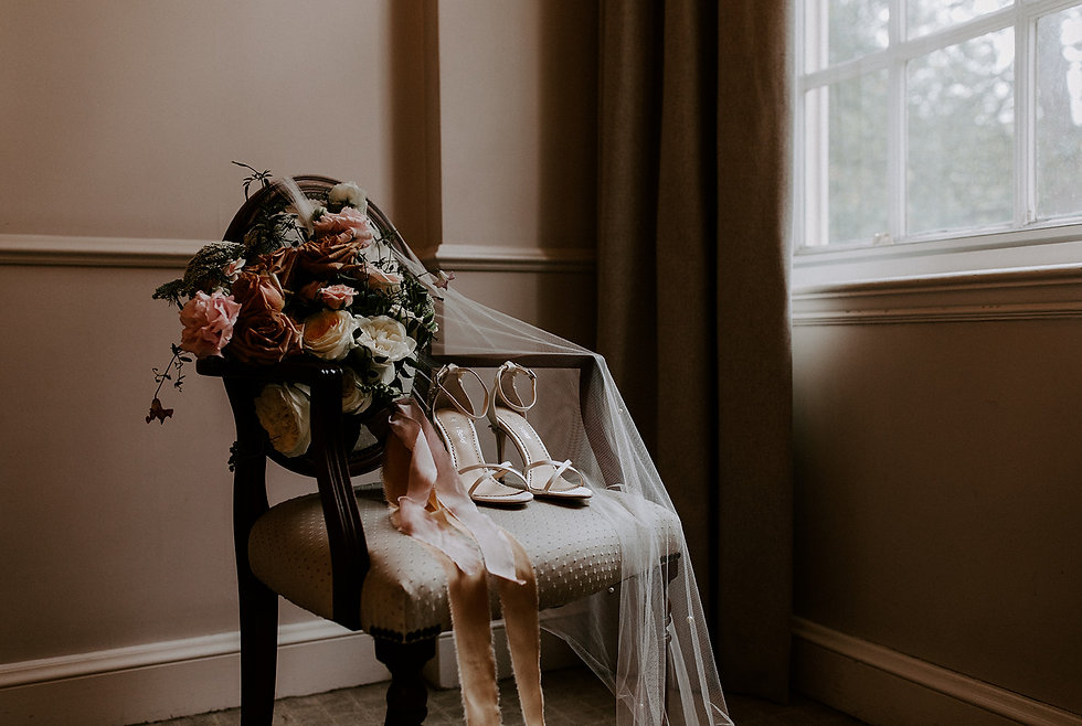 Wedding bouquet and Bella Belle shoes with veil on chair