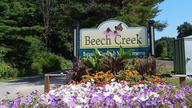 Welcome sign for Beech Creek Gardens with artwork on it of pink flowers and a butterfly.