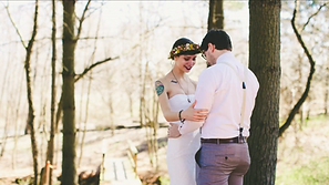 Young couple in their wedding clothes outside in nature