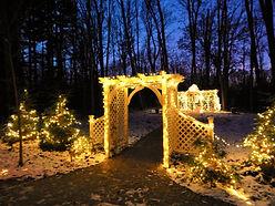Gazebo lit with yellow holiday lights.