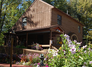 Wooden building with beautiful pink and purple flowers