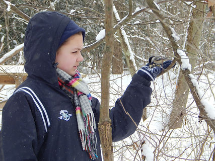 Child in winter with bird in hand