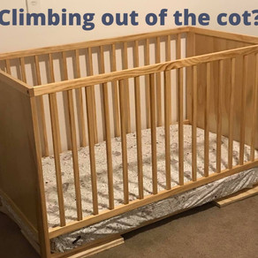 Climbing out of the cot