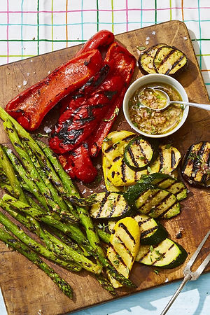 grilled vegetables with honey thyme vinaigrette on a wooden plate