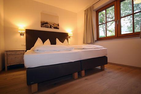 Schlafbereich mit Boxsprinbett