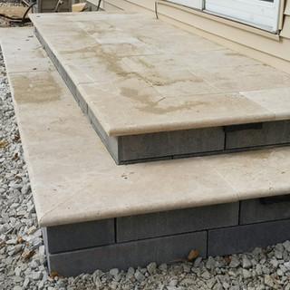 Travertine step tread on lamina wall risers