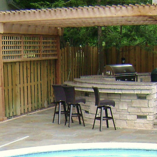 Pergola covered outdoor kitchen