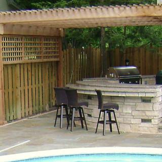 Pergola covered outdoor kitchen