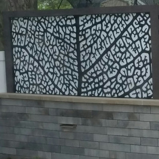 Laser cut art screen with water weir