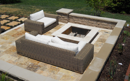 Travertine fire pit area with seating wa