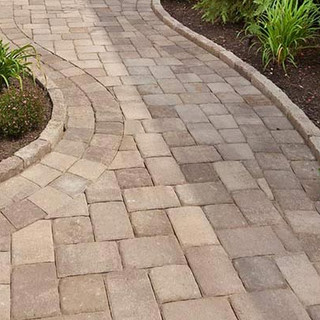 Paver walkway with turned up edge