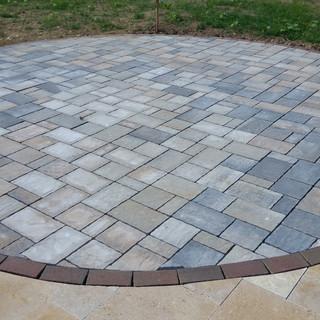 Concrete paver inlay to the travertine p