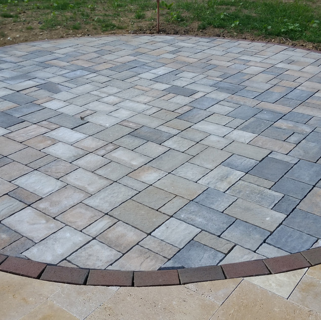 Concrete paver inlay to the travertine p