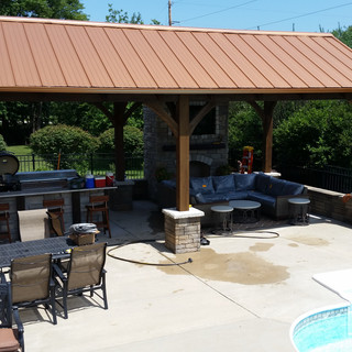 Outdoor living and dining with metal roo