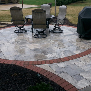 Silver travertine edged in clay pavers
