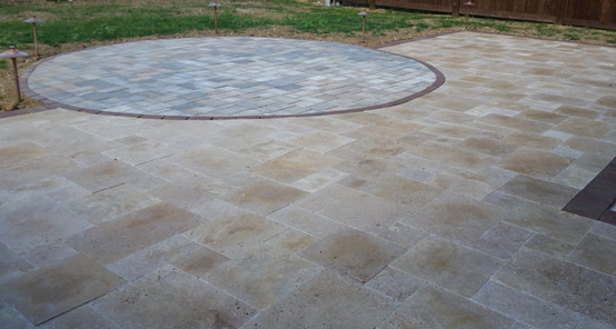Travertine patio with concrete paver inl