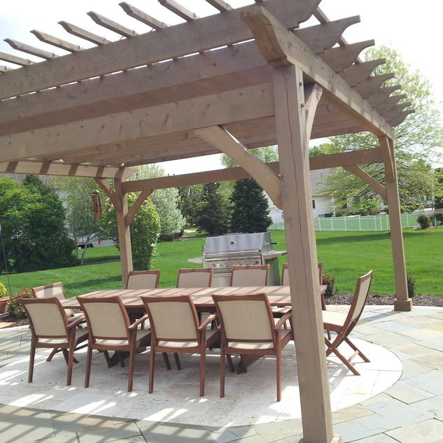 Pergola with bluestone patio and inlay