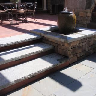Rock faced steps off of deck