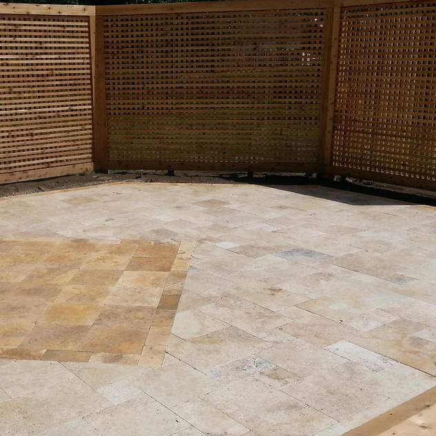 Solid screen and travertine patio