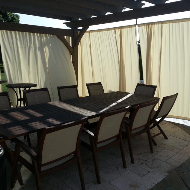 Pergola with closed curtains
