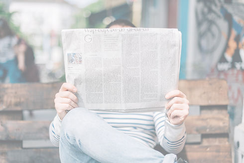 Person%20reading%20a%20newspaper_edited.