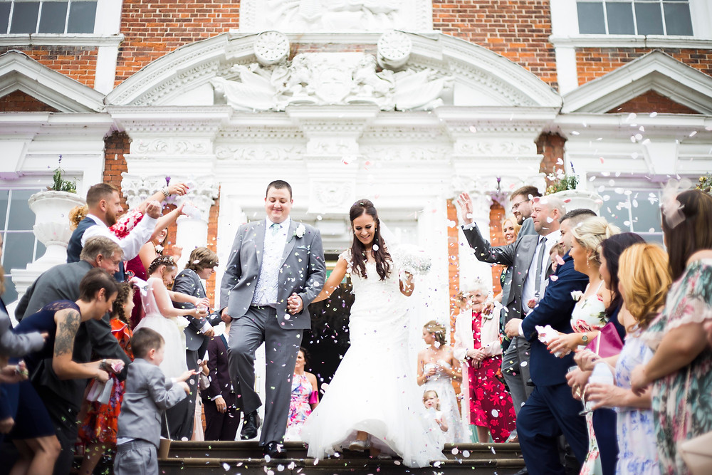 Confetti on the steps of Croxteth Hall Wedding