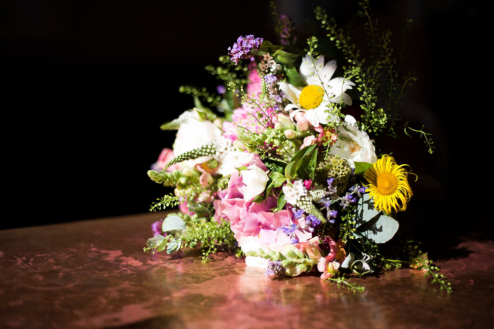 wildflower bridal bouquet with pinks purples and yellows