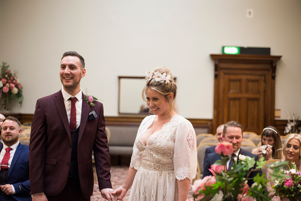 Bride and groom laughing during their St Georges Hall wedding ceremony