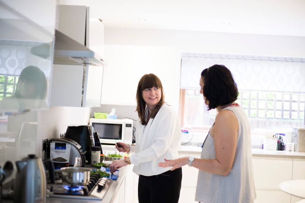 Margaret Bell Health Coach cooking with a client during personal branding photography