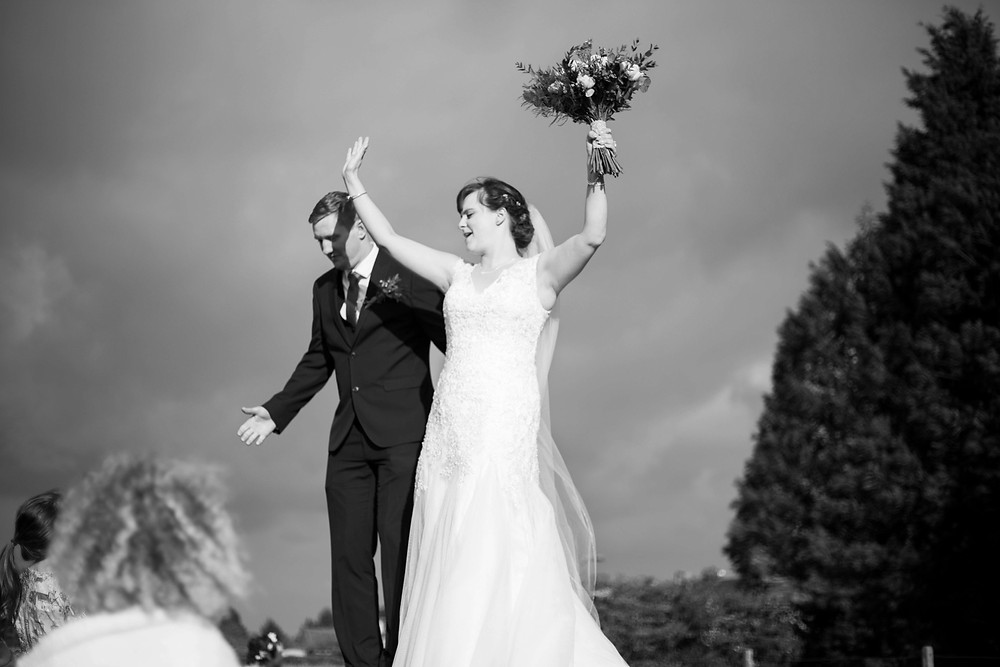 Bride and groom dancing on tables Parr Hall farm wedding