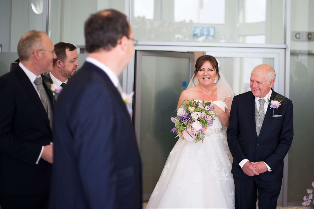 Bride and father walking down the aisle Liver building wedding