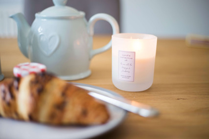 Breakfast table set up with lit candle. Personal branding photography liverpool