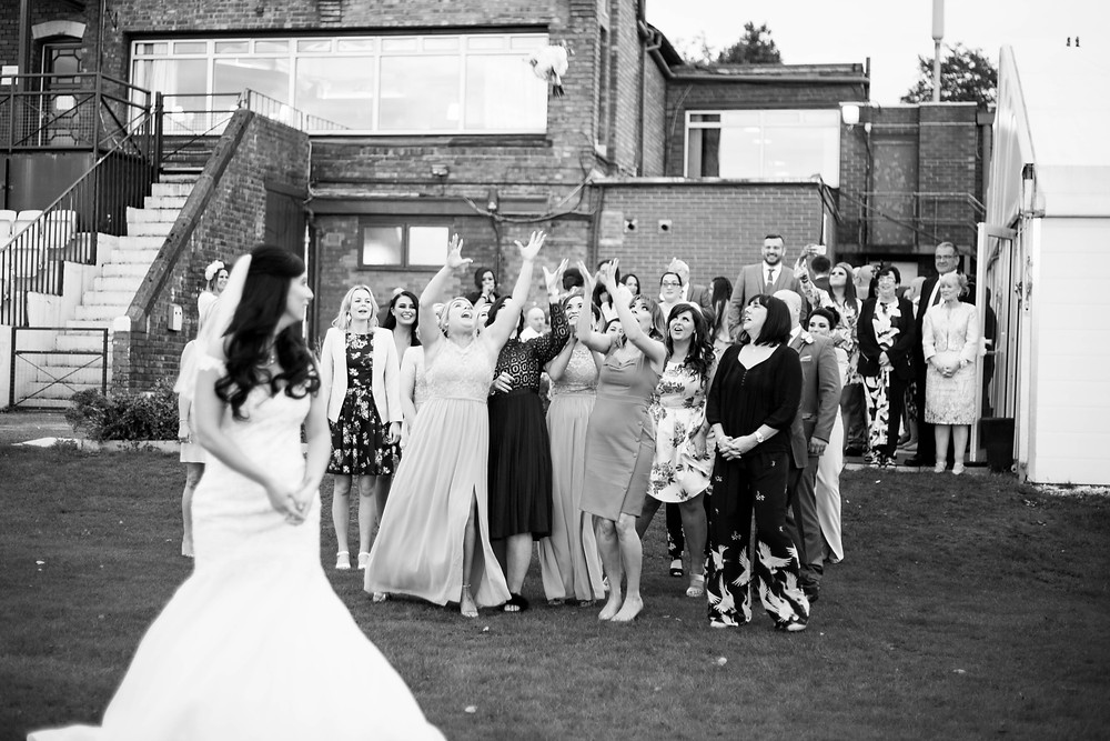 Bouquet toss Liverpool cricket club wedding
