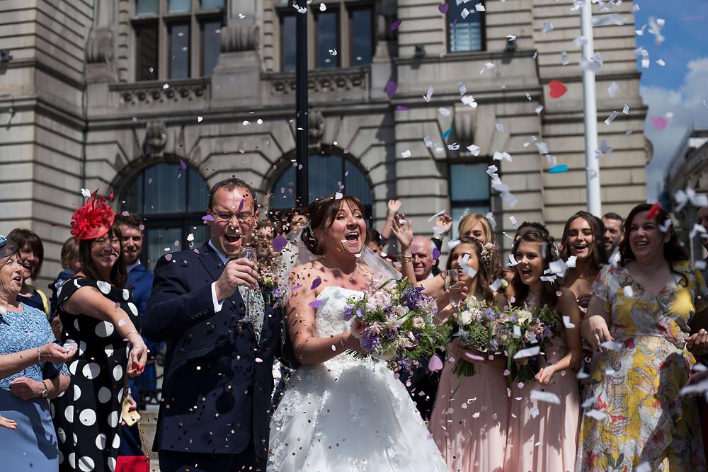 Confetti cannon outside Liver building Liverpool Wedding