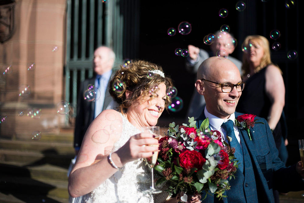 Bubbles outside Liverpool Cathedral wedding