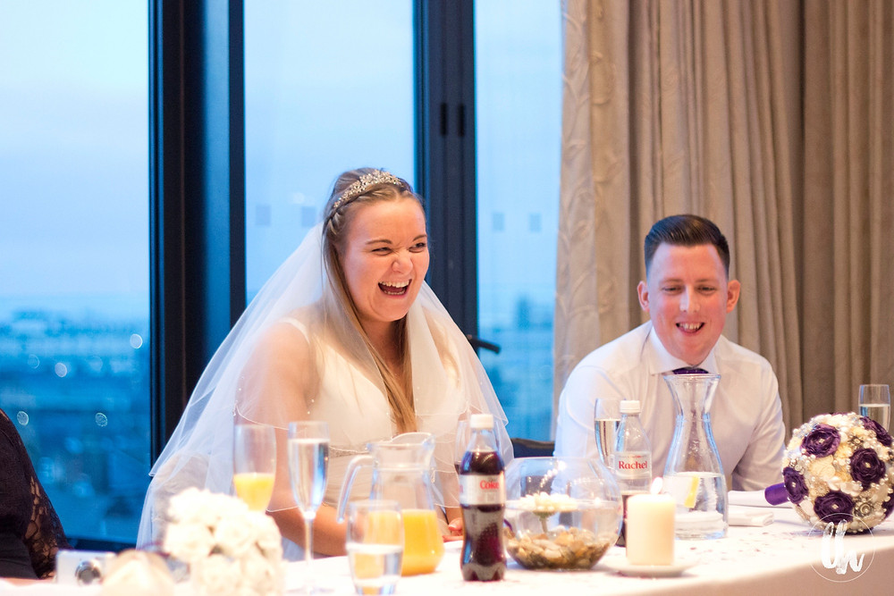 Bride and goom laughing at Hope Street Hotel