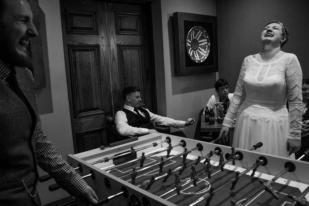 Bride and groom playing games at thornton hall hotel wedding