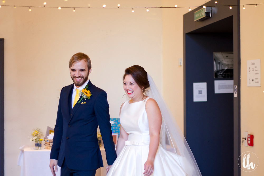 Bride and groom enter their Bluecoat wedding reception