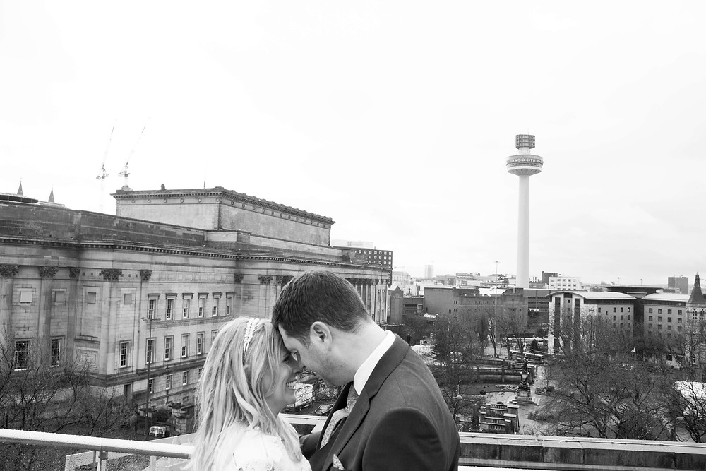 Liverpool central library rooftop with bride and groom