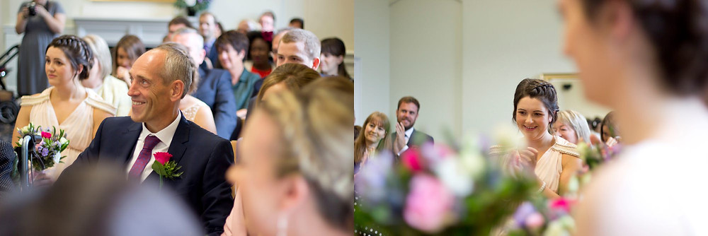 Guests smiling during the wedding ceremony