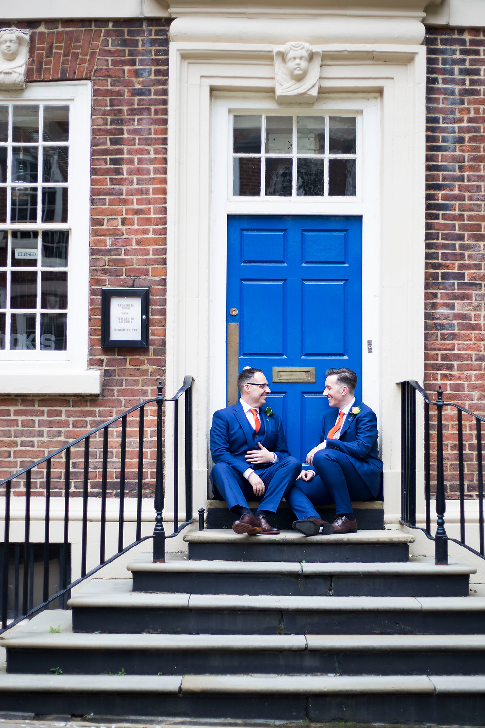 Grooms outside blue door at Bluecoat wedding liverpool