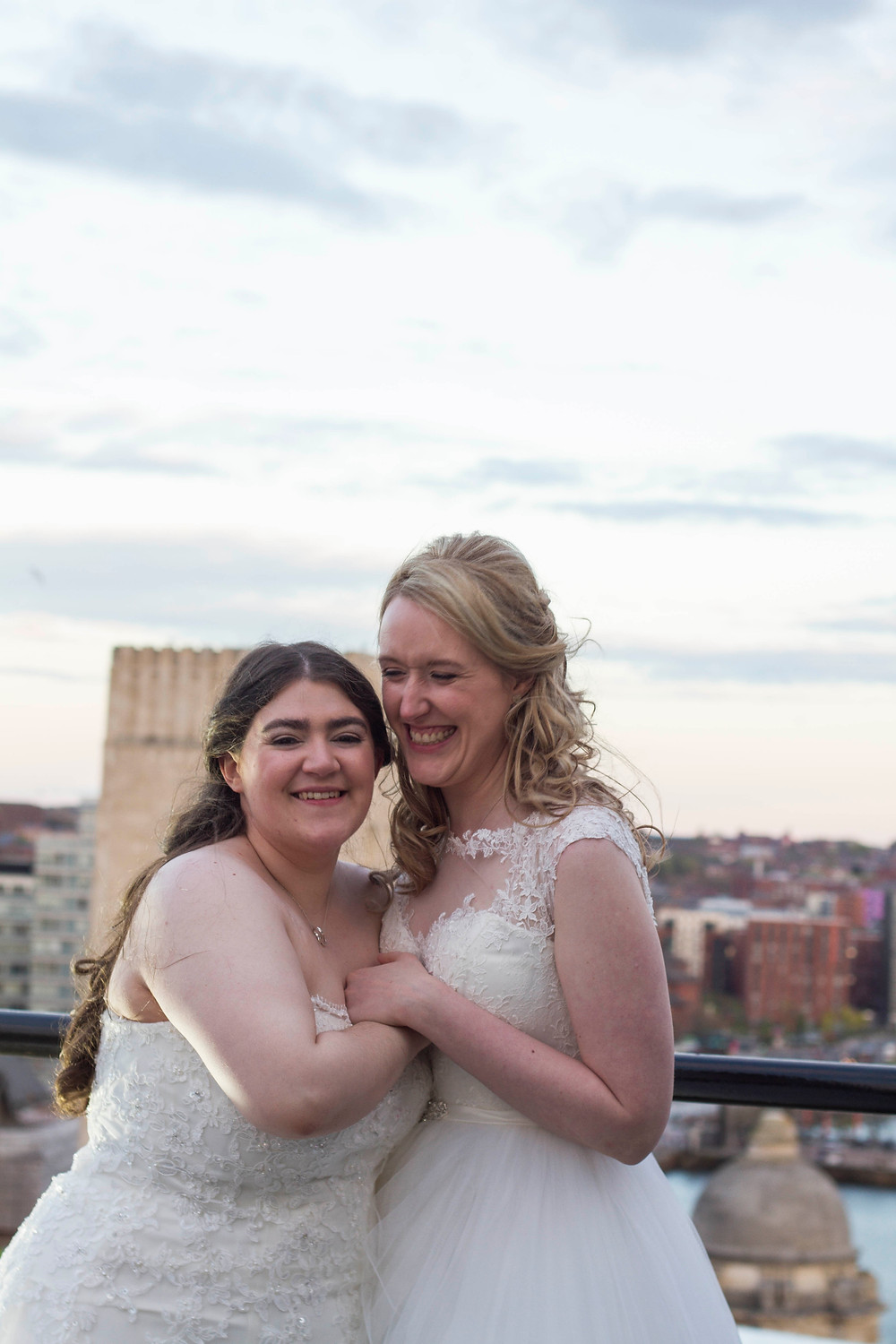 Happy brides on top of the Liver Building