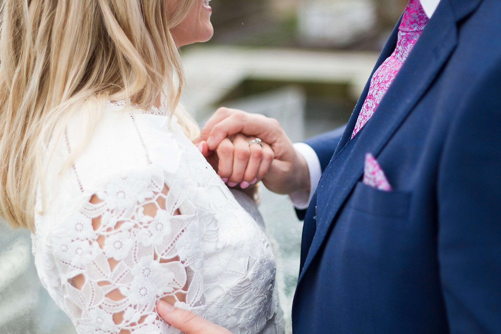 wedding rings and holding hands liverpool elopement