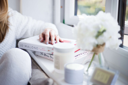 Woman relaxing with books and candles personal branding photography liverpool