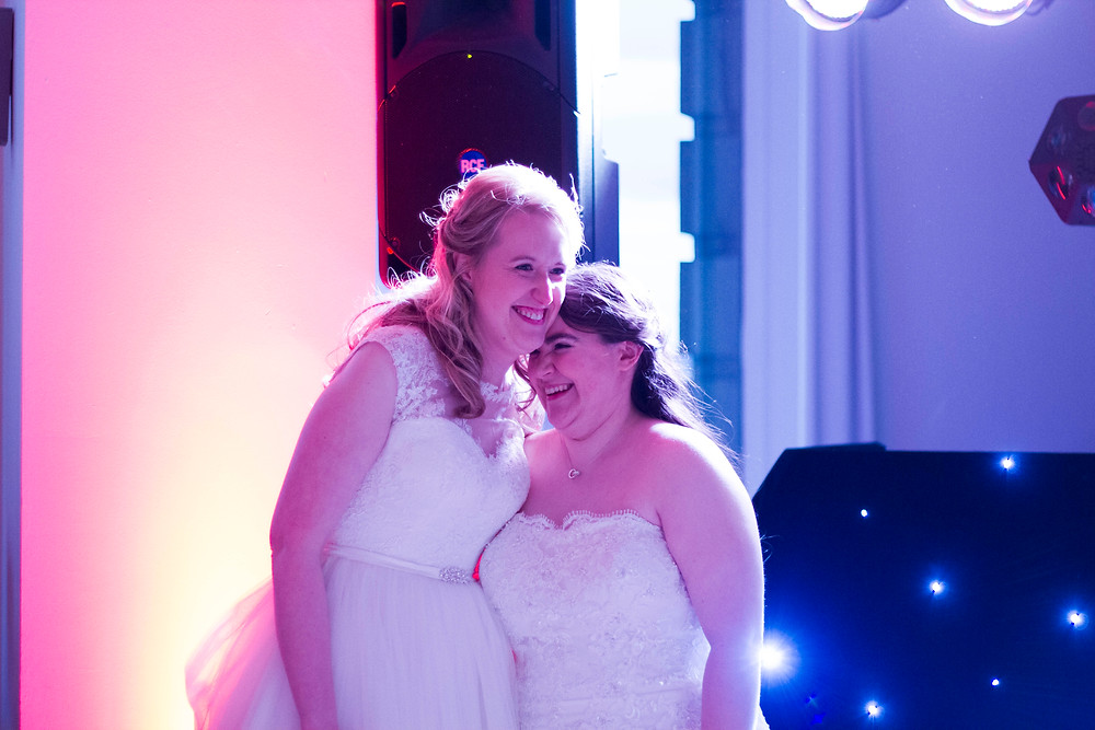 Two brides about to start their first dance
