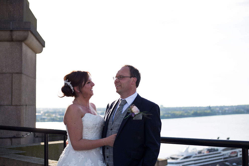 Bride and groom Liver building rooftop