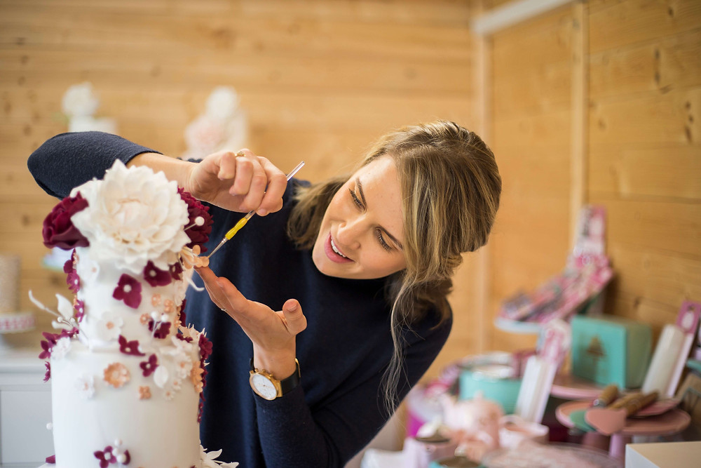 Elizabeth Harris Cakes Personal Branding Photography decorating maroon floral wedding cake