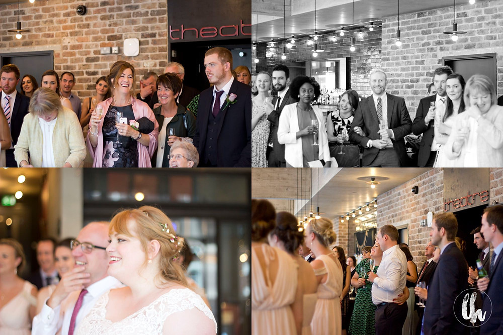 guests laughing during speeches at Everyman theatre wedding