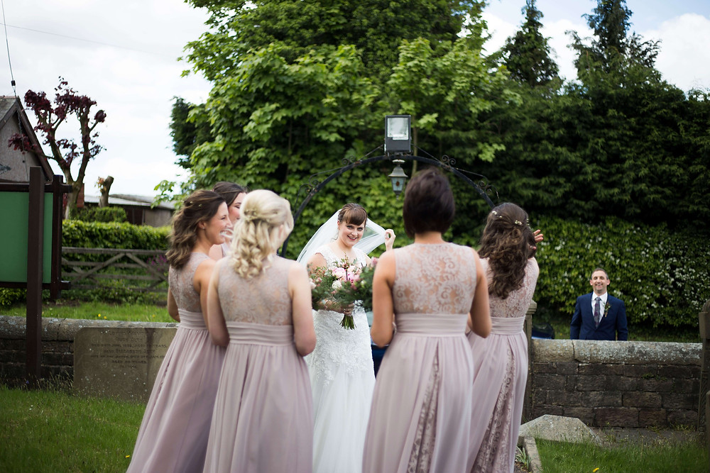 Bride and bridesmaids waiting to enter church wedding liverpool